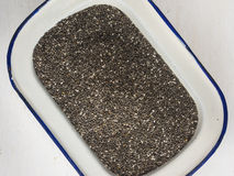 Chia seeds in a white enamel  dish Royalty Free Stock Photography