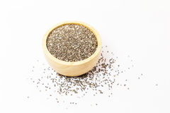 Chia seeds in wood cup on white background Stock Photography