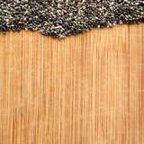 Chia Seeds on wood grain cutting board, square format for social media, banners and background stock images