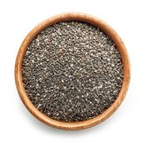Chia seeds in wooden bowl. Isolated on white background, top view royalty free stock image