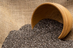 Chia seeds with wooden bowl Royalty Free Stock Photo