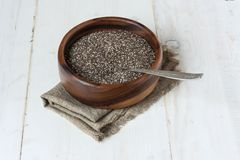 Chia seeds in a wooden bowl Royalty Free Stock Photos