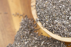 Chia seeds. In wooden plate on a wooden background Stock Image