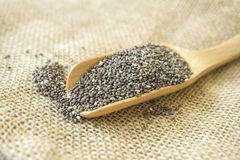 Chia seeds in a wooden scoop. Chia seeds are among the healthiest foods, Chia Seeds Should be Able to Help You Lose Weight Stock Photo