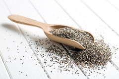 Chia seeds in wooden scoop Royalty Free Stock Photos