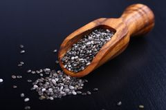 Chia seeds in wooden scoops, one of the superfoods Royalty Free Stock Images