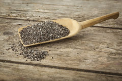Chia seeds on wooden shovel Stock Photos