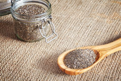 Chia seeds in a wooden spoon and jar. Royalty Free Stock Image