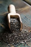 Chia seeds on a wooden table. Chia seeds close up on wooden background royalty free stock image