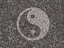 Chia seeds with Yin Yang symbol. Healthy organic chia seeds with a Yin Yang symbol Stock Photography