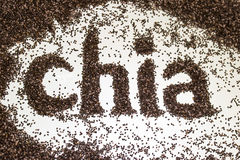 Chia word made from chia seeds Salvia hispanica on white background. Royalty Free Stock Photo