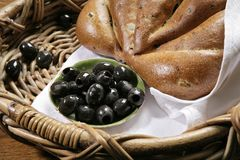 Chiabatta with olives on bakery basket Stock Image