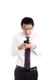 Chiacchierando con lo smartphone Immagine Stock Libera da Diritti