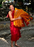 Chiahg Mai, Thailand: Young Monk Carrying Robes Royalty Free Stock Images