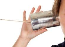 Chiamata di telefono con una latta Fotografia Stock