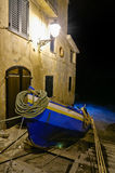 Chianalea the boat away. A boat of Chianalea (Scilla, Reggio Calabria) away before the arrival of bad weather at night Royalty Free Stock Photos