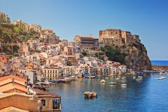 Chianalea di Scilla. Scilla castle Ruffo, and harbor with fishing boats in Calabria, southern Italy stock images