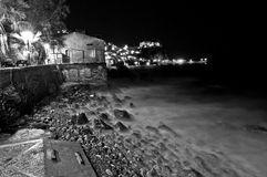 Chianalea by night. A view of the village of Scilla Chianalea (Reggio Calabria) at night, with heavy sea royalty free stock photography