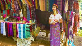 CHIAND RAI, THAILAND: Kayan Lahwi (Long-Necked Kayan) woman with neck rings in hill tribe village near her shop. stock video
