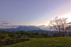 Chiang Dao Mountains in Winter - Thailand. Beautiful mist and sunset in Thailand Stock Image