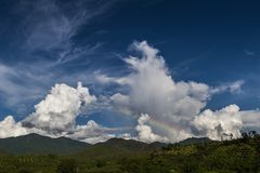 Chiang Mai mountain view with amazing cloudy blue sky and rainbow. Thailand countryside stock photos