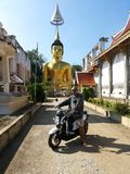 Chiang Mai - November 8, 2014: Man riding a motorcycle tour to the Temple in Chiang Mai, Thailand Stock Images