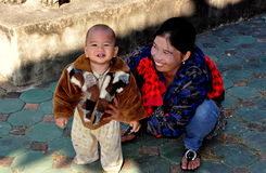 Chiang Mai, TH: Mother and Child at Thai Wat Royalty Free Stock Photo