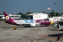 Chiang Mai,TH: Nok Airways Airbus. A NOK Airways Airbus jet with its distinctive white and purple colours parked at a gate at the Chiang Mai, Thailand Stock Photography