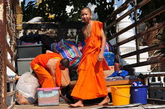 Chiang Mai, TH: Teenaged Monks in Truck. Two teenaged monks loading a truck with supplies at Wat Suan Dok in Chiang Mai, Thailand Royalty Free Stock Photography