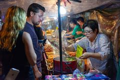 Man buys dumplings Royalty Free Stock Image