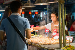 CHIANG MAI, THAILAND - CIRCA AUGUST 2015: Local people sell traditional Thai food and drinks at night market in Chiang Mai,  Thail Royalty Free Stock Photo