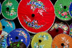 Chiang Mai, Thailand: Colourful Paper Parasols. A colourful display of the famed paper parasols made at the Sa Paper & Umbrella Handicraft Centre at Borsang stock photography