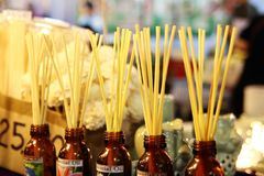 Chiang Mai, Thailand - December 2, 2017: Glass bottles with essential oils and wooden sticks. royalty free stock photography
