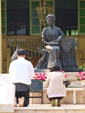 Chiang Mai, Thailand- February 27-Closeup of couple of older pro. Strate themselves to worship Princess Dara Rasmi statue in Daraphirom Palace on February 27 stock image