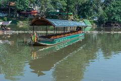 CHIANG MAI, THAILAND - FEBRUARY 18: river boat cruise for rent waiting for tourists to experience the atmosphere of the Ping River. In Chiang Mai. It is a Stock Photos