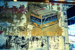 Peeling painted sign of of old Kodacolor film sign on citty stre Stock Photography