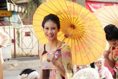 CHIANG MAI, THAILAND-FEBUARY 7 :. Anniversary Chiang Mai Flower Festival 39 th 2015, Unidentified woman hold umbrella in parade annual Chiang Mai flower festival Royalty Free Stock Photo