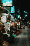 Chiang Mai, Thailand, 12.16.18: Hipster girl walking alone in the streets. Some businesses are still open. royalty free stock photography