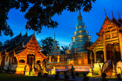 Chiang Mai, Thailand. Illuminated temples of Phra Singh. In Chiang Mai, Thailand at sunset. Golden walls and blue sky Royalty Free Stock Photos