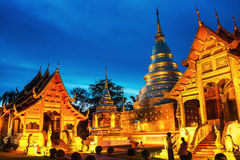 Chiang Mai, Thailand. Illuminated temples of Phra Singh. In Chiang Mai, Thailand at sunset. Golden walls and blue sky stock image