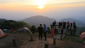 CHIANG MAI THAILAND - JAN 11,2016 : large number of camping tourist seeing sun rising sky at doi ang-khang most popular winter tra. Veling destination in stock video