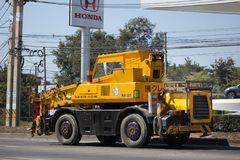 KATO Crane MR-100 of ST Construction Company. CHIANG MAI, THAILAND -JANUARY 22 2018: KATO Crane MR-100 of ST Construction Company.Photo at road no 121 about 8 stock images