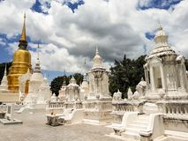 A temple in Chiang Mai. Chiang Mai, Thailand - July 31, 2017: a sacred temple in Chiang mai in a cloudy day royalty free stock image