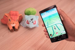 CHIANG MAI,THAILAND - JULY 20,2016 :An Android user reads the wa. Rning screen for the new Pokemon Go app. that was released on July 6, 2016. It is reality Royalty Free Stock Photos