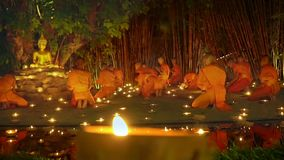 Asalha Puja Day, Chiang Mai, Thailand. Chiang Mai Thailand - July 8: Asalha Bucha is an important day in Buddhist religion. Monk light a candles to pray the stock footage
