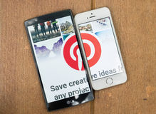 CHIANG MAI, THAILAND - JULY 17,2016:Brand Apple iPhone 5s and LG. G4 with showing screen shot of Pinterest. Pinterest is an online pinboard that allows people Royalty Free Stock Photos