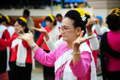 CHIANG-MAI, THAILAND - JULY 3: Thailand Festival for donating money to the temple for publishing Buddhism. The women dance to worship on July 03, 2017 at Stock Image