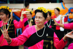 CHIANG-MAI, THAILAND - JULY 3: Thailand Festival for donating money to the temple for publishing Buddhism. The women dance to worship on July 03, 2017 at Royalty Free Stock Photo