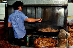 Chiang Mai, Thailand: Man Cooking Pork Rinds Stock Image