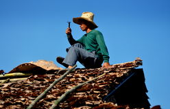 Chiang Mai, Thailand: Man Repairing Roof Stock Images